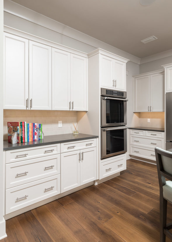 White kitchen cabinets with recessed panel doors