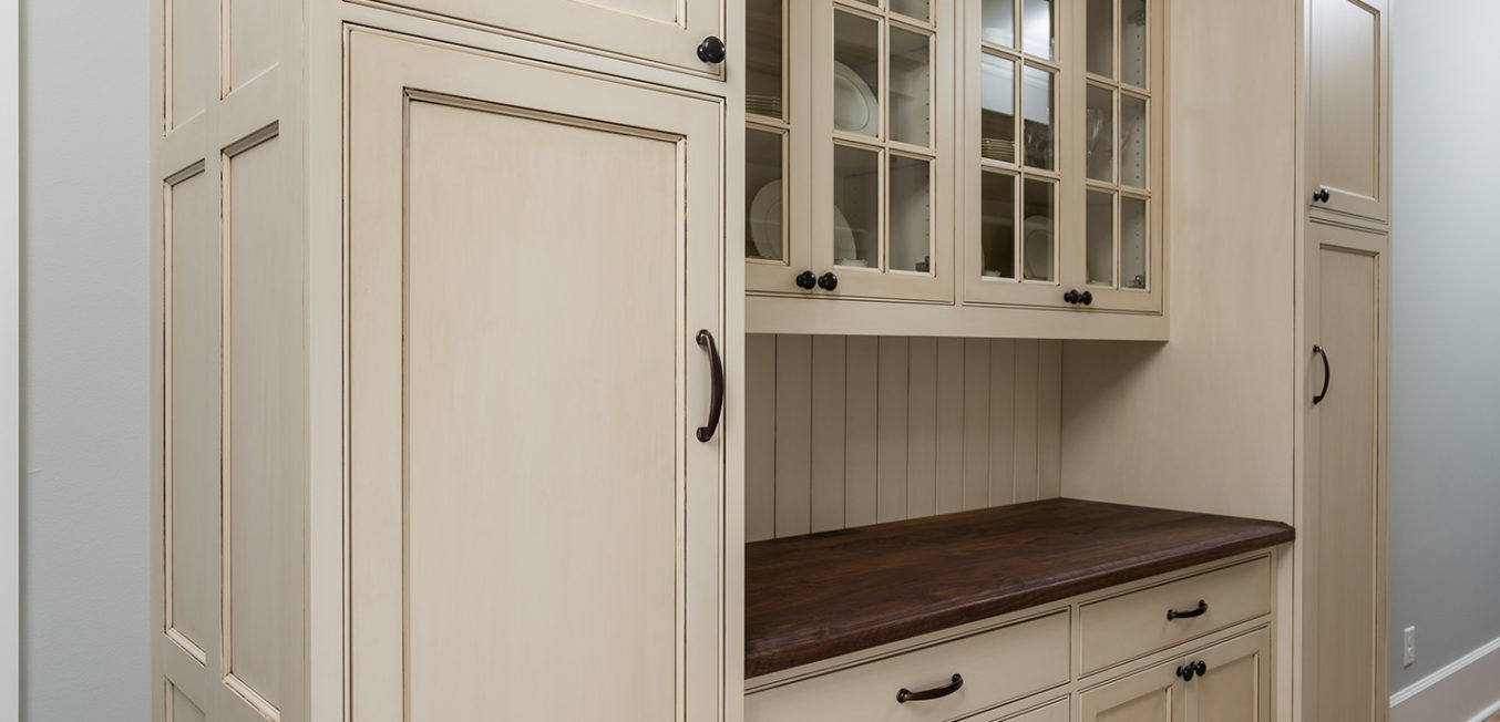 Light beige kitchen cupboard cabinet with inset shaker doors and Mullion decorative upper doors