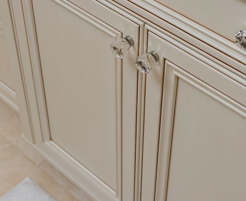 Decorative recessed panel doors with crystal knobs on a full overlay vanity