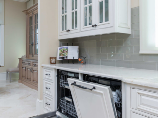 The dishwasher appliance panels give this Highpoint kithen a seamless look.
