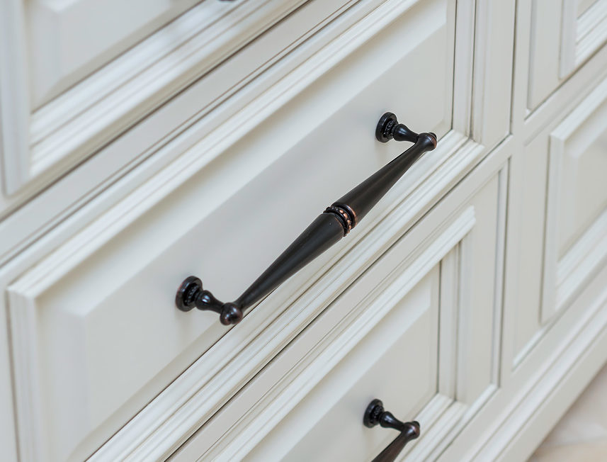 Off white painted full overlay cabinet drawers with raised panel drawer fronts