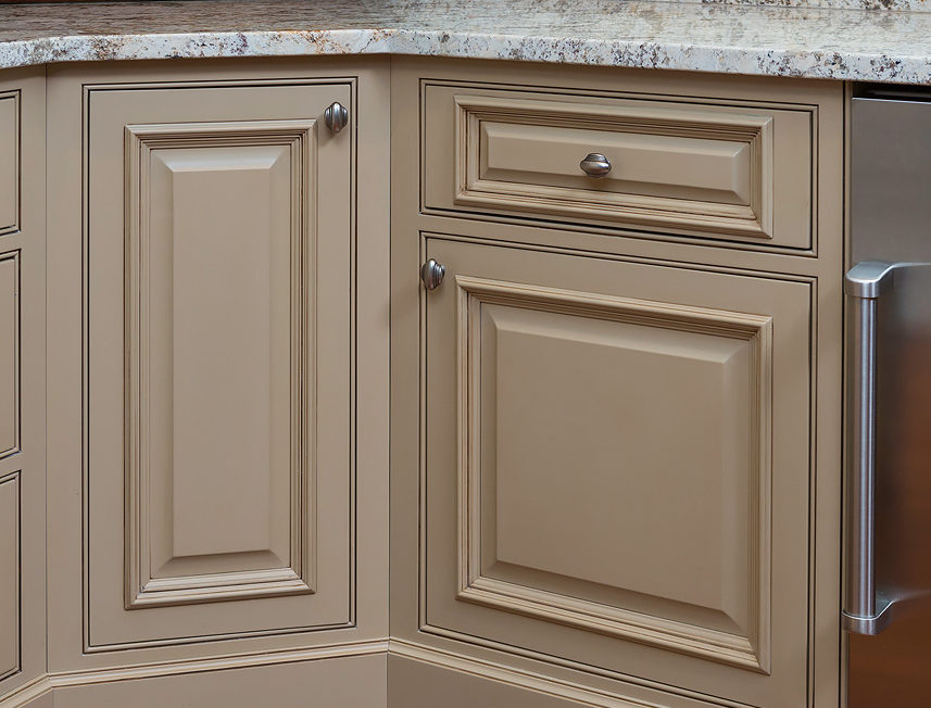 Tan Inset bar cabinetry with raised panel door fronts