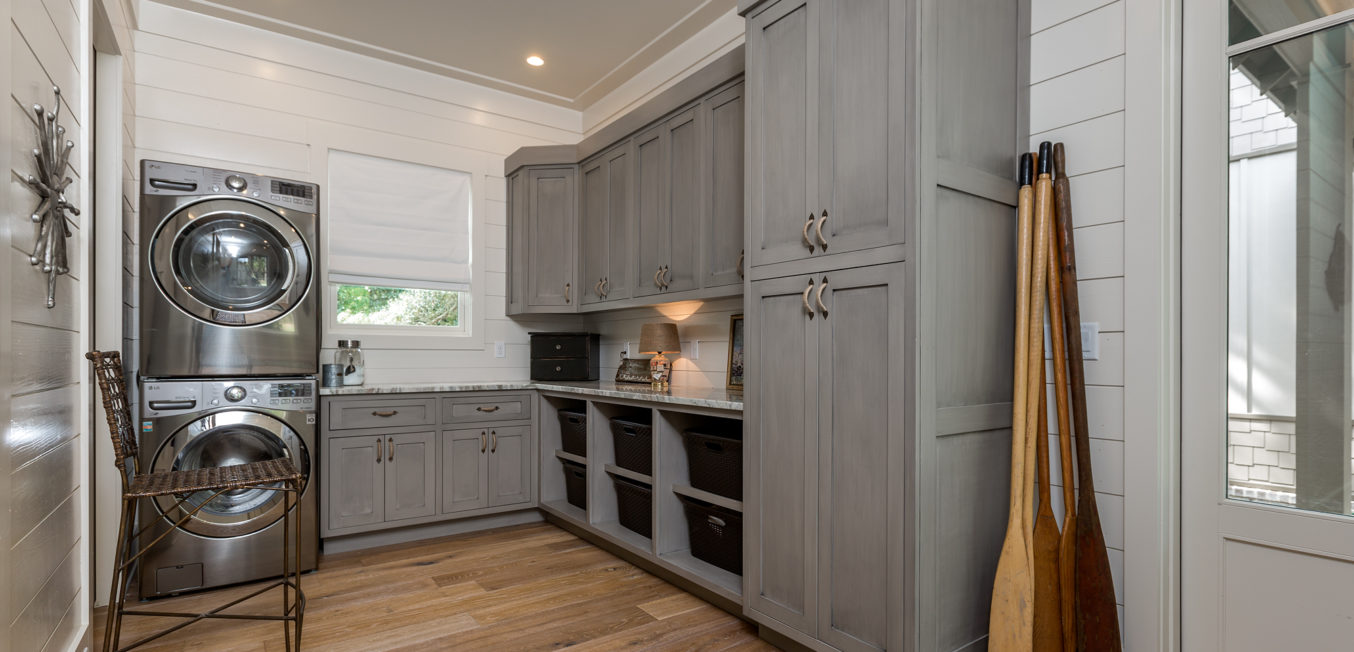 Gray Inset Laundry room cabinetry with shaker style doors