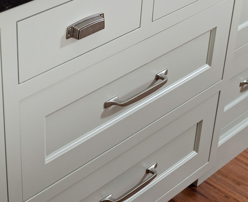 Slab and Recessed panel drawer fronts inset into a custom kitchen cabinet