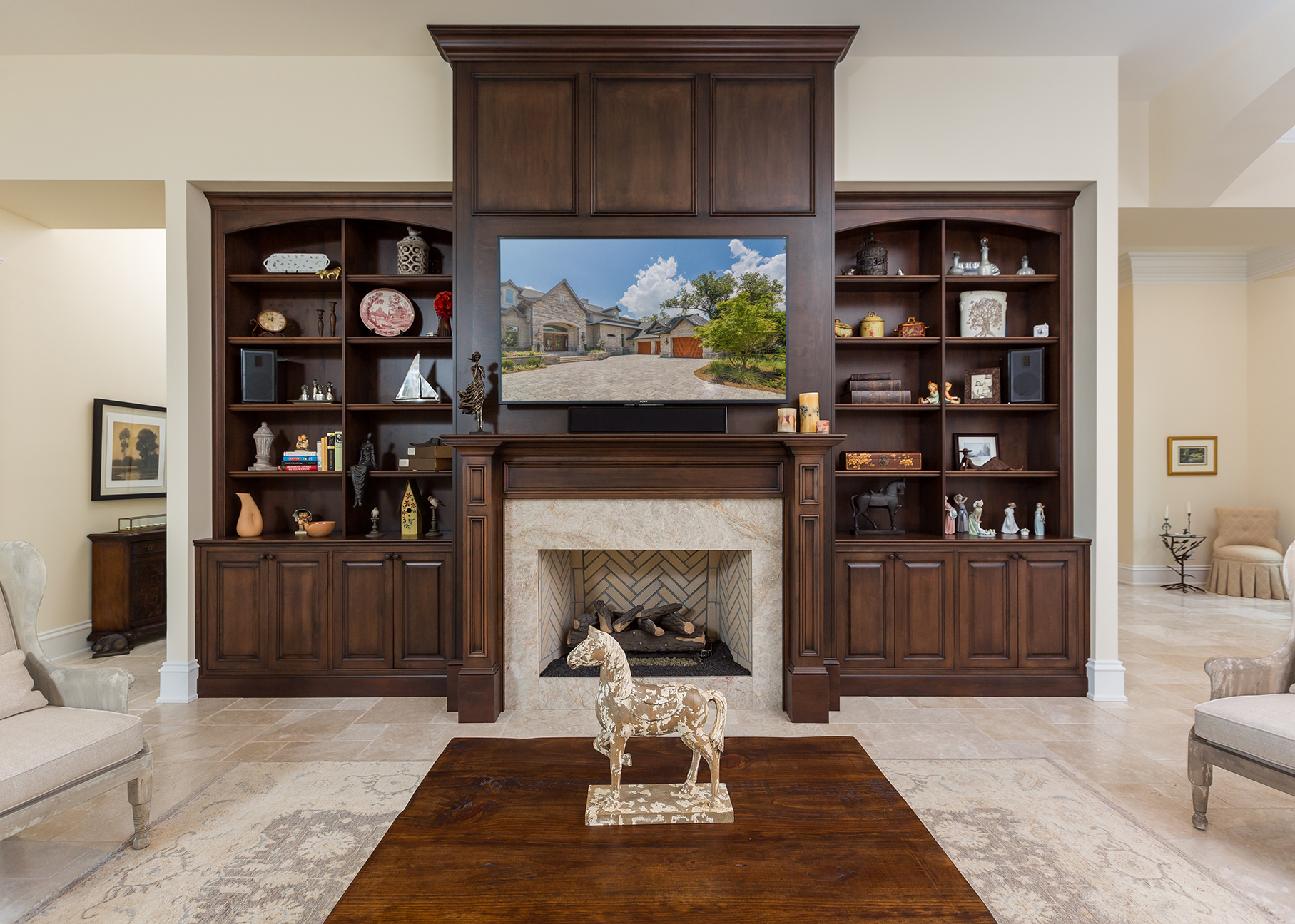 This dark stained entertainment center has shelving on the sides and lower raised panel doors for storage