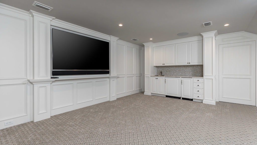 Custom Wall Paneling in Entertainment room
