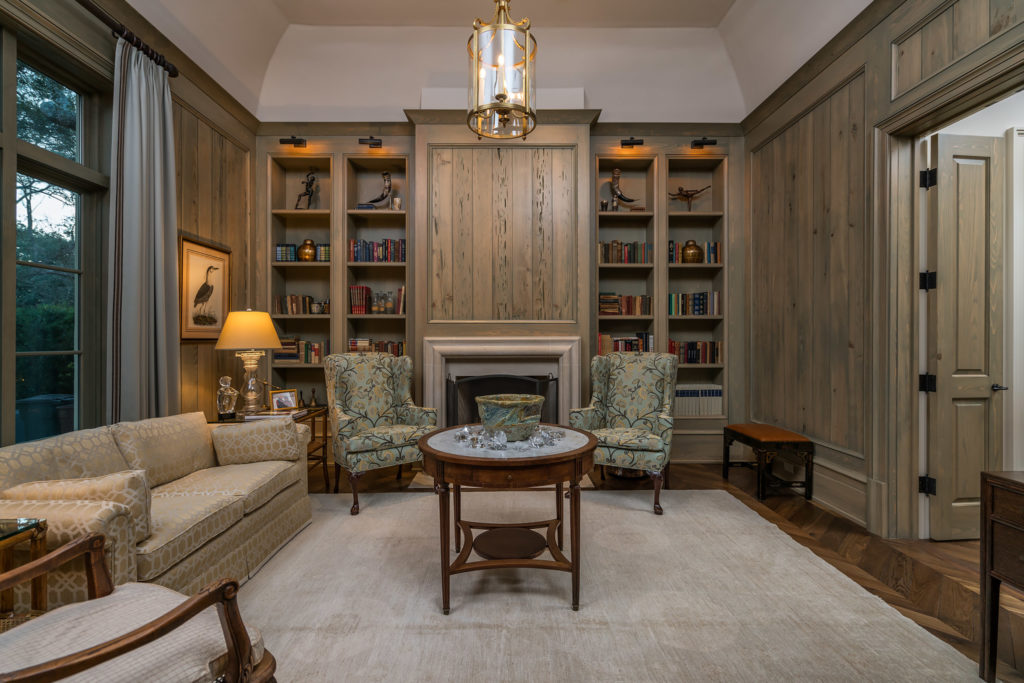 Blue Bell Home custom study built out of pecky cypress with a hidden bookshelf door