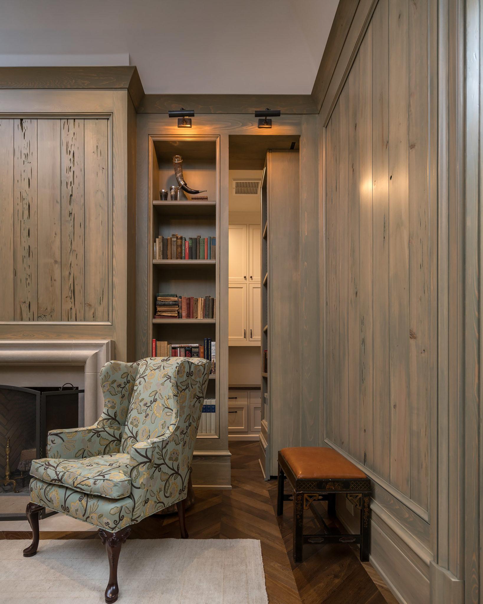 Blue Bell Home custom study built out of pecky cypress with a hidden bookshelf door