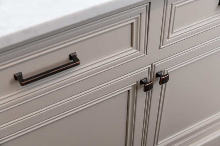 White inset pantry island cabinet with decorated recessed panel doors and Top Knobs Hardware: Contour knob and Ascendra Pull in Umbria