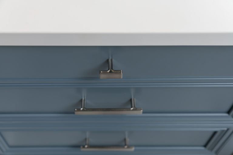 Jeffery Alexander Anwick Knob on a slab drawers and Pulls on recessed panel drawers