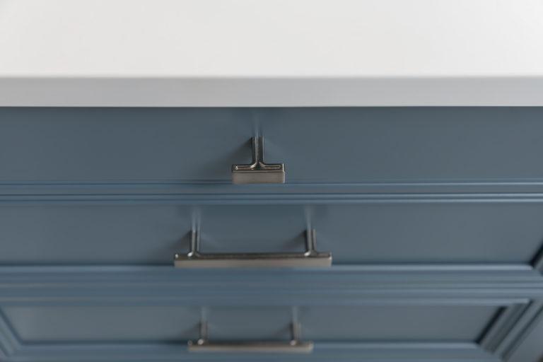 Jeffery Alexander Anwick Knob on a slab drawers and Pulls on recessed panel drawers