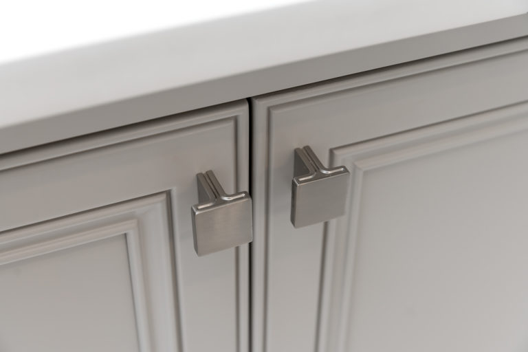 Jeffery Alexander Anwick Knob in Satin Nickel on beige painted doors with decorate recessed panels