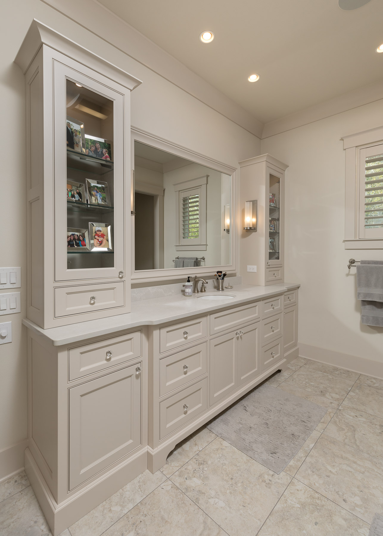Beige painted master bathroom with glass panel doors and recessed panels